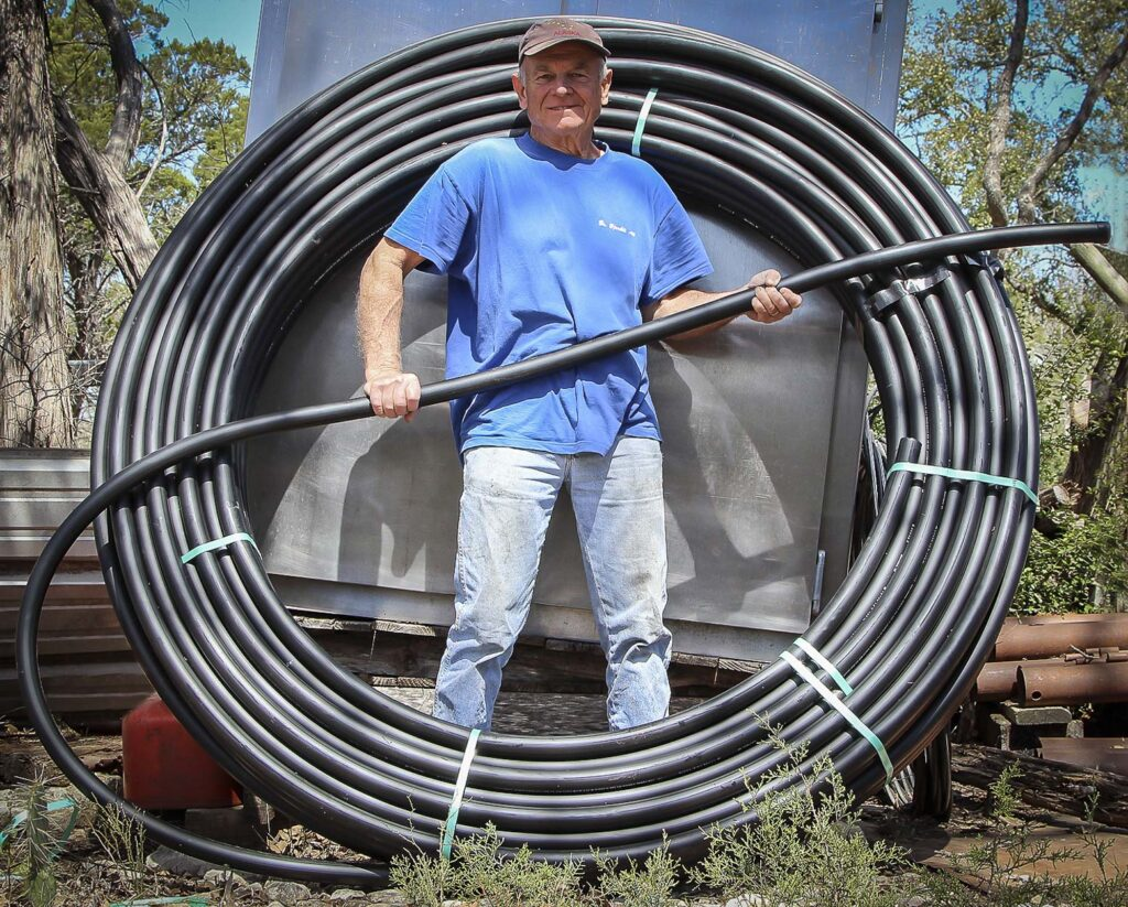 Terry Raines with Poly Pipe